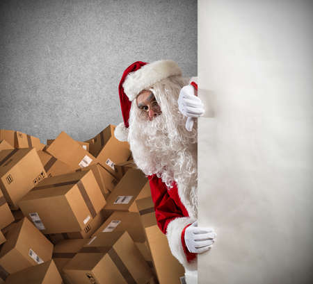 Photo for Santa Claus ready to deliver a lot of Christmas presents package - Royalty Free Image