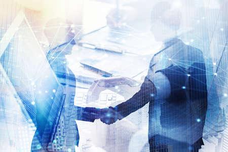 Foto de Abstract business handshake. Concept of partnership and teamwork. Double exposure - Imagen libre de derechos