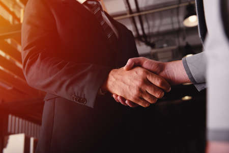 Photo for Handshaking business person in office. concept of teamwork and partnership - Royalty Free Image