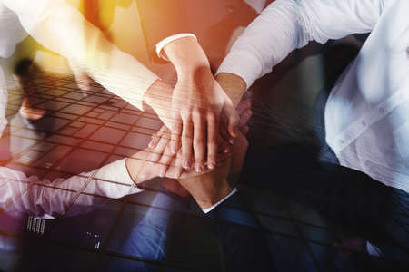 Photo for Business people joining hands in a circle in the office. concept of teamwork and partnership. double exposure - Royalty Free Image