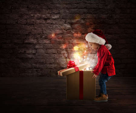 Photo for Child that open a magic Christmas gift - Royalty Free Image