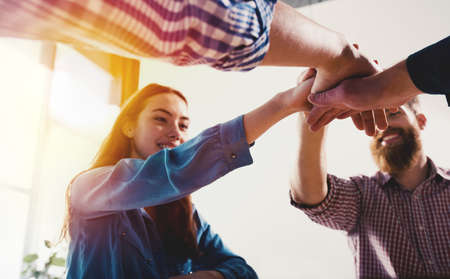 Foto de Business people putting their hands together. Concept of teamwork and partnership - Imagen libre de derechos