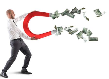 Photo pour Businessman attracts money - image libre de droit