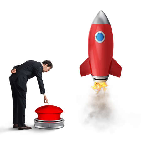 Foto de Businessman launches rocket pushing a red button. 3D Rendering - Imagen libre de derechos