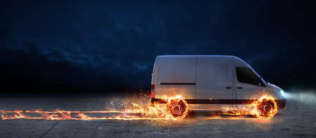 Foto de Super fast delivery of package service with van with wheels on fire - Imagen libre de derechos