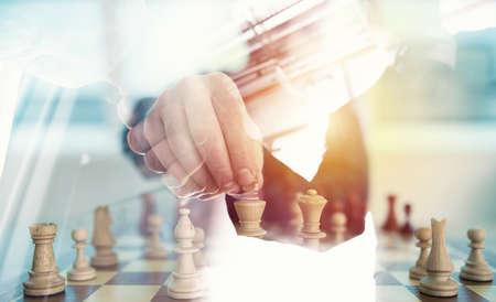 Foto de Business strategy with chess game and handshaking business person in office. concept of challenge and tactic. double exposure - Imagen libre de derechos