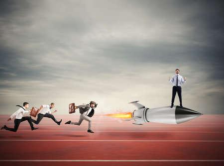 Foto de Winner businessman over a fast rocket. Concept of business competition - Imagen libre de derechos