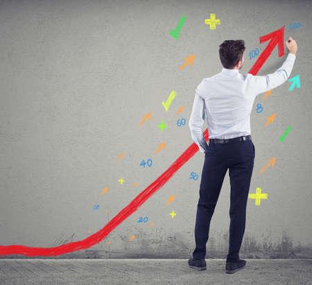 Businessman draws positive statistics of his company. Concept of success