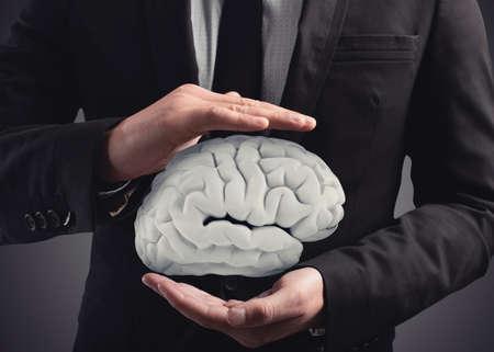 Foto de Man protects a brain with his hands. 3D Rendering - Imagen libre de derechos