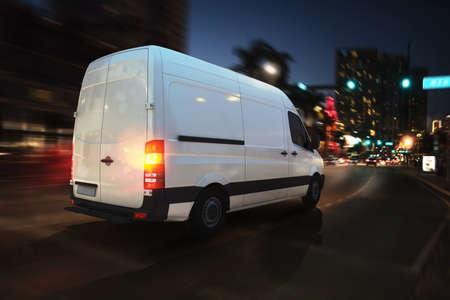 Foto de Fast van on a city road delivering at night. 3D Rendering - Imagen libre de derechos