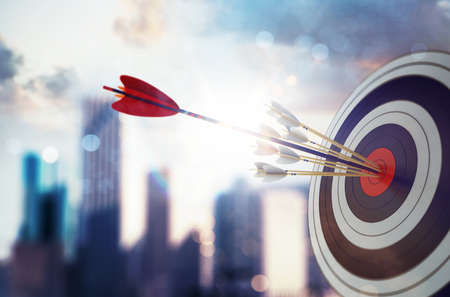 Photo pour Arrow hit the center of target with modern skyscraper background. Business target achievement concept. 3D Rendering - image libre de droit