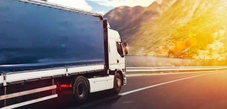 Photo pour Truck run fast on the highway to deliver - image libre de droit