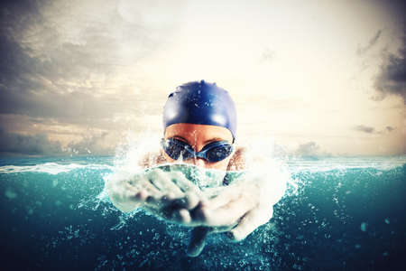 Photo for Athlete swims in a blue deep water - Royalty Free Image