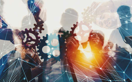 Photo pour Business team connect pieces of gears. Teamwork, partnership and integration concept with network effect. double exposure - image libre de droit
