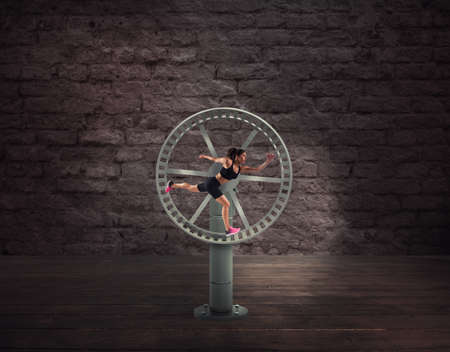Photo for Athletic woman runs in a looping wheel. concept of sport routine - Royalty Free Image