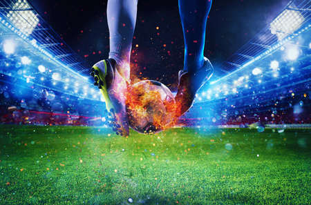 Photo for Soccer players with soccerball on fire at the stadium during the match - Royalty Free Image