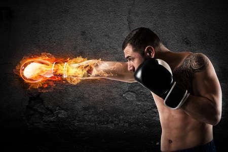 Photo for Confident boxer with fiery boxing gloves - Royalty Free Image