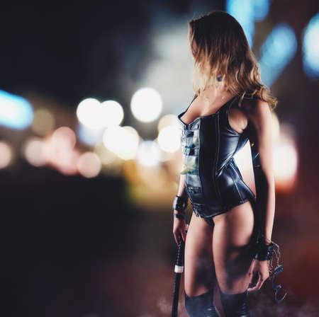 Foto de Sensual provocation of a sexy bdsm woman with whip - Imagen libre de derechos