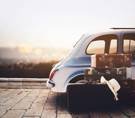 Photo pour Car on the road ready for summer holiday during sunset with luggage - image libre de droit