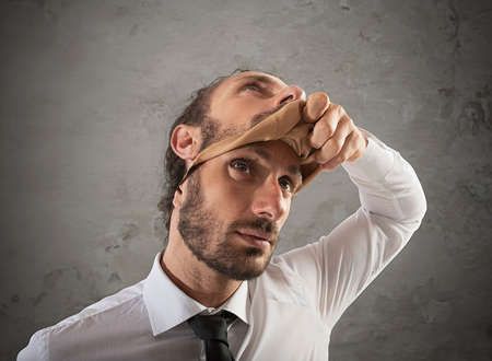 Photo for Businessman that removes the mask. Concept of falsity - Royalty Free Image