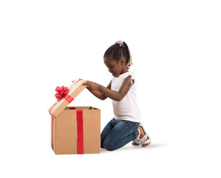 Photo for Happy little girl with a Christmas gift - Royalty Free Image