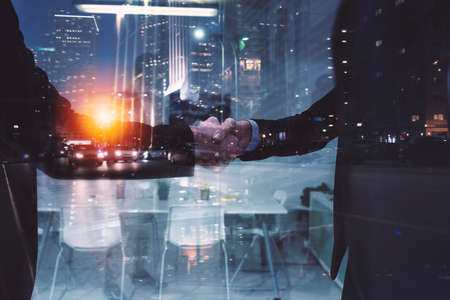 Photo for Handshaking business person in office. concept of teamwork and partnership. double exposure - Royalty Free Image
