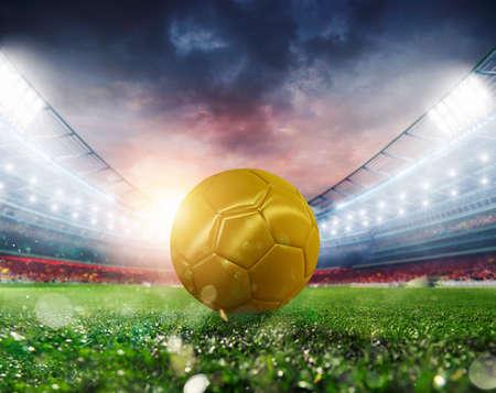 Photo pour Golden Soccerball at the stadium ready for match - image libre de droit