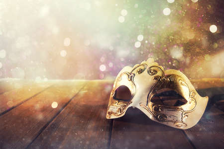 Photo for Stll life of a carnival mask on a wood floor - Royalty Free Image