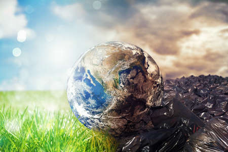 Foto de Earth is chancing due to pollution and undifferentiated trash. Save the World. World provided by NASA - Imagen libre de derechos