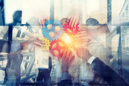 Photo pour Business team connect pieces of gears. Teamwork, partnership and integration concept. double exposure - image libre de droit