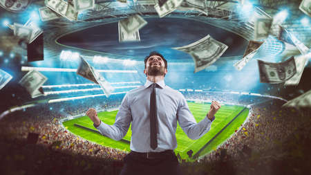 Photo pour Man who rejoices at the stadium for winning a rich soccer bet - image libre de droit