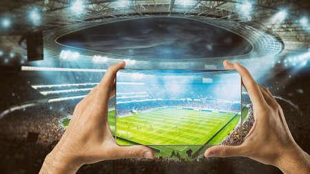 Photo pour Watch a live sports event on your mobile - image libre de droit