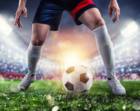 Photo pour Soccer player ready to kick the soccerball at the stadium during the match. - image libre de droit