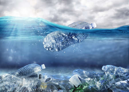 Photo pour Floating bottle. Problem of plastic pollution under the sea concept - image libre de droit
