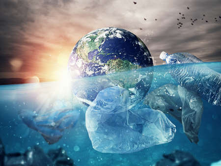 Photo pour The Earth floats in the sea full of plastic. Save the word - image libre de droit