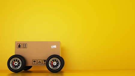Photo pour Cardboard box with racing wheels like a car on a yellow - image libre de droit