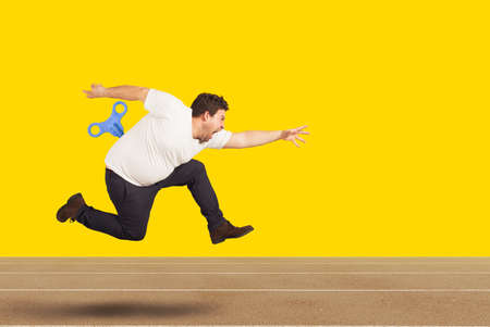 Photo pour Fat man runs very fast without getting tired with extra energy - image libre de droit