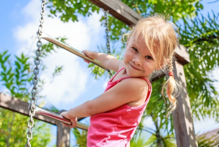 Photo for the girl on the playground - Royalty Free Image