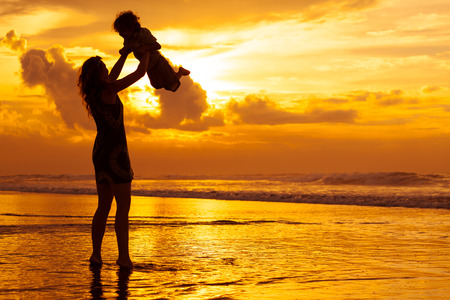Photo for mother and  son playing on the beach in dawn time - Royalty Free Image