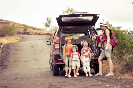 Photo pour three little kids and mother in the mountains - image libre de droit
