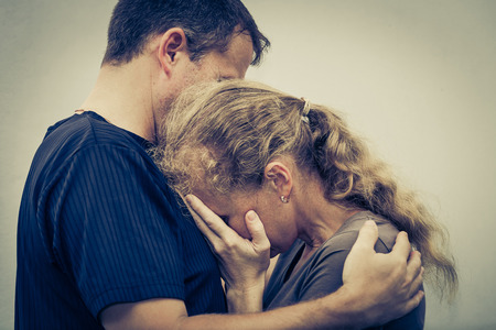 Photo pour Sad woman hugging her husband - image libre de droit