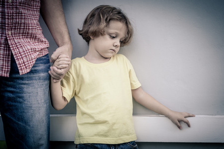 Photo for portrait of one sad son hugging his father at the day time - Royalty Free Image