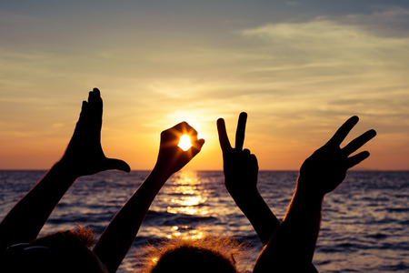 Photo pour Love  sign language at the sunset time - image libre de droit