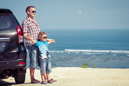 Photo pour Father and son playing on the beach at the day time. Concept of friendly family. - image libre de droit
