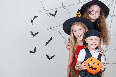 Photo for Happy brother and two sisters on Halloween party - Royalty Free Image