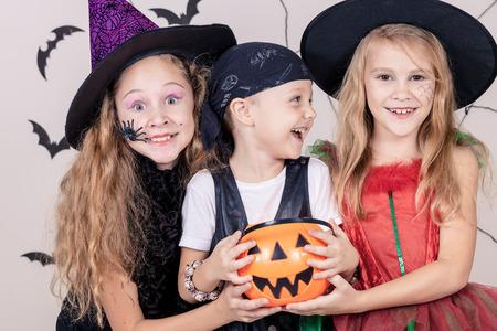 Foto de Happy brother and two sisters on Halloween party - Imagen libre de derechos