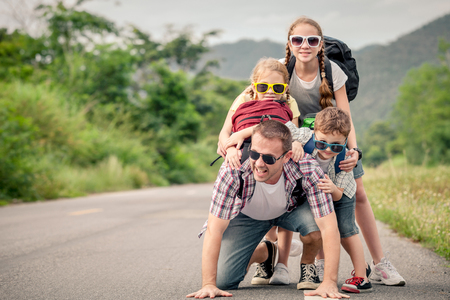 Photo pour Father and children walking on the road at the day time.  Concept of friendly family. - image libre de droit