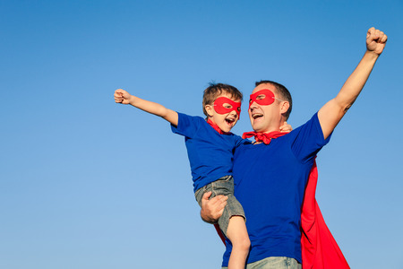 Photo for Father and son playing superhero at the day time. People having fun outdoors. Concept of friendly family. - Royalty Free Image