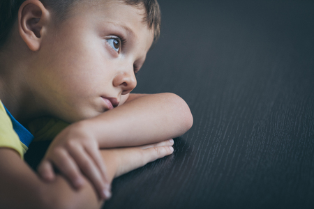 Photo pour Portrait of one sad little boy. Concept of sorrow. - image libre de droit