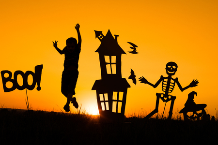 Photo for Happy little boy playing outdoors at the sunset time. Kid having fun. Concept of happy Halloween party. - Royalty Free Image